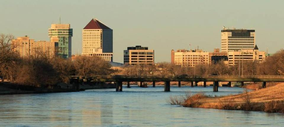 A skyline of Wichita, Kansas showing the Arkansas River.